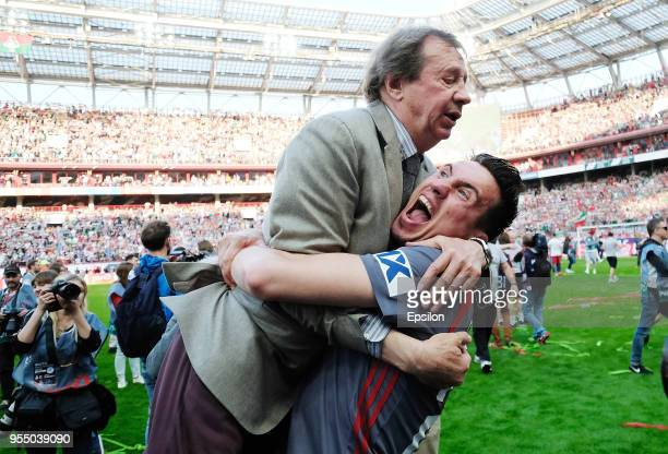 Head coach Yuri Semin and player Boris Rotenberg of FC Lokomotiv Moscow celebrate after their victory over FC Zenit Saint Petersburg in the Russian...