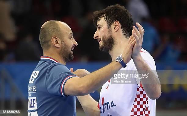 Head coach Zeljko Babic and Domagoj Dunjak of Croatia after the 25th IHF Men's World Championship 2017 match between Croatia and Belarus at Kindarena...