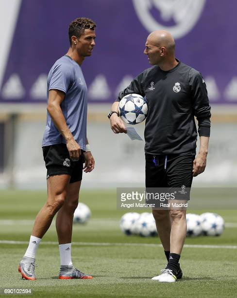 Head coach Zinedine Zidane and Cristiano Ronaldo of Real Madrid during a training session at Valdebebas training ground on May 30 2017 in Madrid Spain