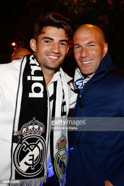 Head coach Zinedine Zidane and Enzo Zidane of Real Madrid celebrate during celebrations at Cibeles Fountain after winning the 2016/17 Spanish...