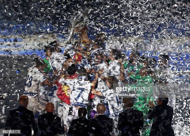 Head Coach Zinedine Zidane and players of Real Madrid celebrate at Santiago Bernabeu Stadium after winning the 2016/17 UEFA Champions League in...