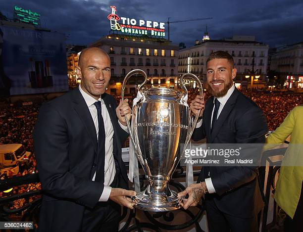 Head coach Zinedine Zidane and Sergio Ramos of Real Madrid hold the trophy during Real Madrid team celebration at Puerta del Sol on May 29 2016 in...