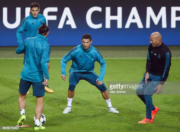 Head coach Zinedine Zidane Cristiano Ronaldo Gareth Bale and Alvaro Tejero attend a Real Madrid training session ahead of their UEFA Champions League...