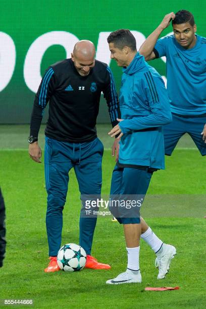 Head coach Zinedine Zidane of Real Madrid and Cristiano Ronaldo of Real Madrid controls the ball during a Real Madrid training session ahead of their...