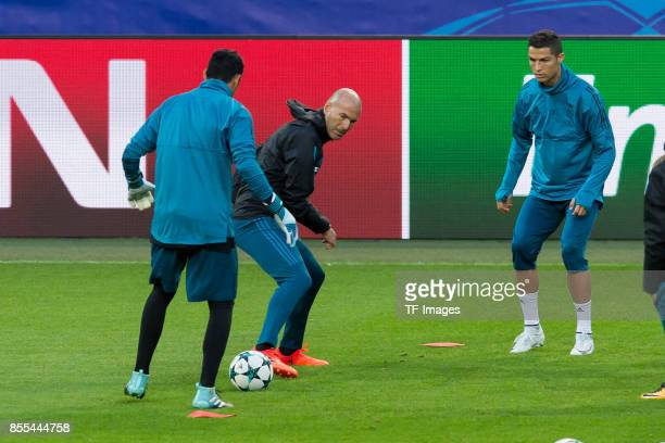 Head coach Zinedine Zidane of Real Madrid and Cristiano Ronaldo of Real Madrid battle for the ball during a Real Madrid training session ahead of...