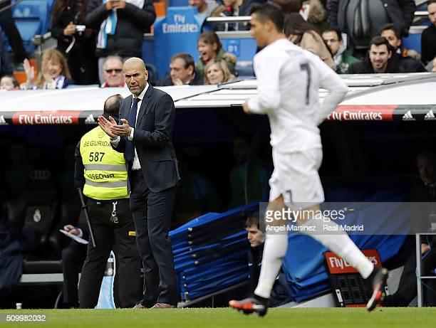 Head coach Zinedine Zidane of Real Madrid applauds to Cristiano Ronaldo during the La Liga match between Real Madrid CF and Athletic Club at Estadio...