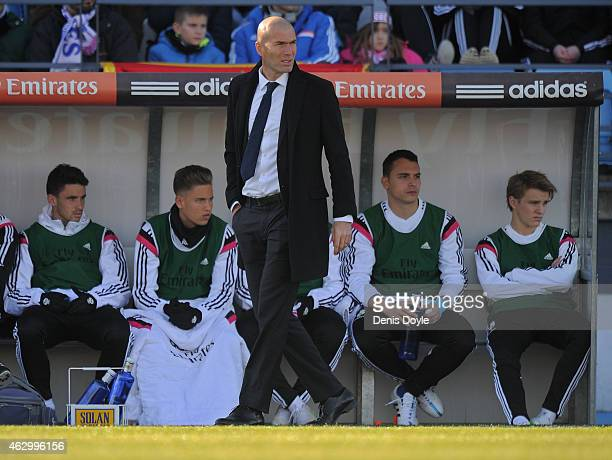 Head coach Zinedine Zidane of Real Madrid Castilla looks on beside new signing Martin Odegaard during the Segunda Division B match between Real...