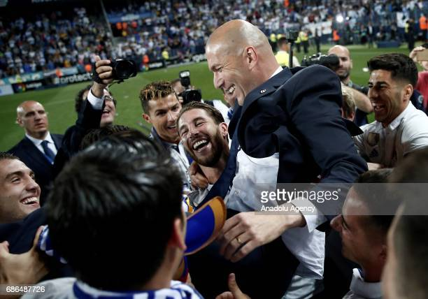 Head Coach Zinedine Zidane of Real Madrid celebrates their championship with his players after the La Liga final match between Malaga and Real Madrid...