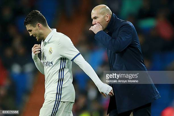Head coach Zinedine Zidane of Real Madrid CF gives instructions to his player Mateo Kovacic during the La Liga match between Real Madrid CF and Real...