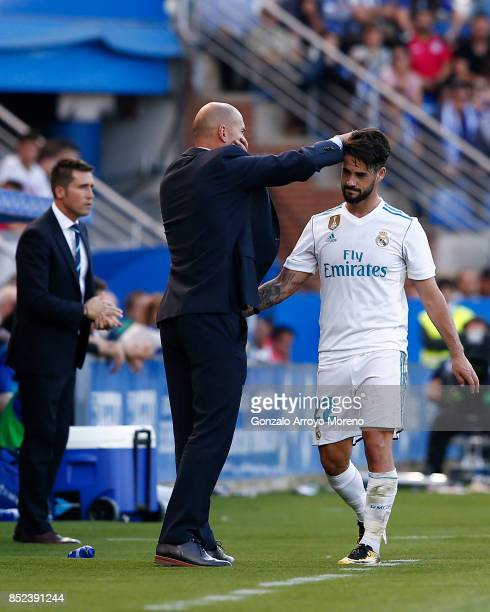 Head coach Zinedine Zidane of Real Madrid CF speaks with his player Francisco Roman Alarcon alias Isco as he leaves the pithc during the La Liga...