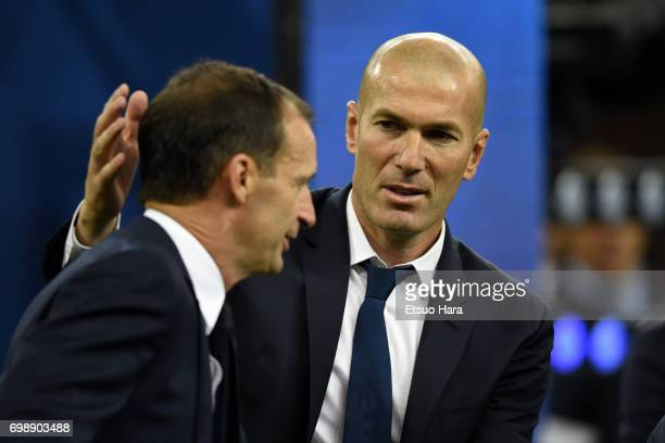 Head coach Zinedine Zidane of Real Madrid consoles head coach Massimiliano Allegri of Juventus after the UEFA Champions League final match between...