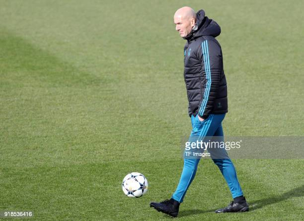 Head coach Zinedine Zidane of Real Madrid controls the ball during a training session at Valdebebas training ground ahead their Round of 16 first leg...