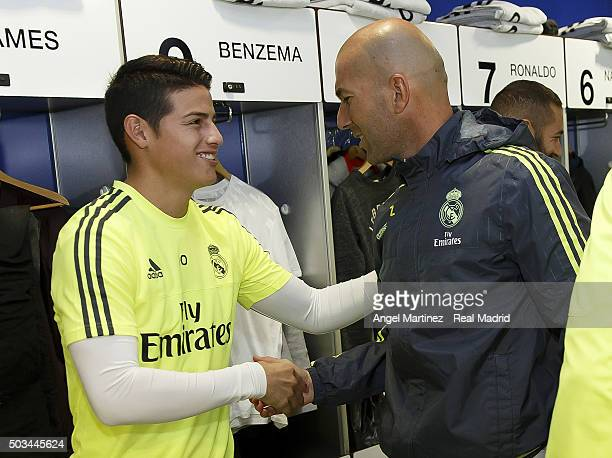 Head coach Zinedine Zidane of Real Madrid greets James Rodriguez before a training session at Estadio Alfredo Di Stefano on January 5 2016 in Madrid...