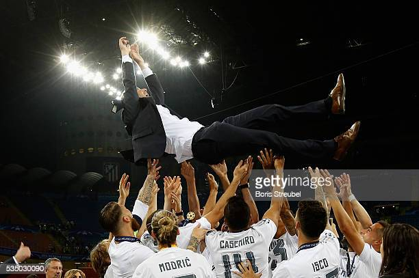 Head coach Zinedine Zidane of Real Madrid is thrown in the air after winning the Champions League final match between Real Madrid and Club Atletico...