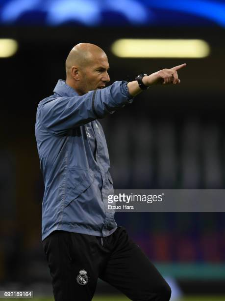 Head coach Zinedine Zidane of Real Madrid looks on during a training session ahead of the UEFA Champions League final between Juventus and Real...