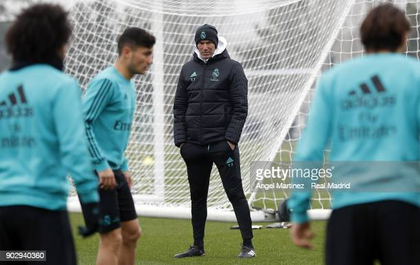 Head coach Zinedine Zidane of Real Madrid looks on during a training session at Valdebebas training ground on January 9, 2018 in Madrid, Spain.