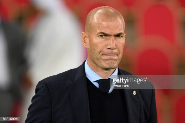 Head coach Zinedine Zidane of Real Madrid looks on prior to the FIFA Club World Cup UAE 2017 semifinal match between Al Jazira and Real Madrid on...