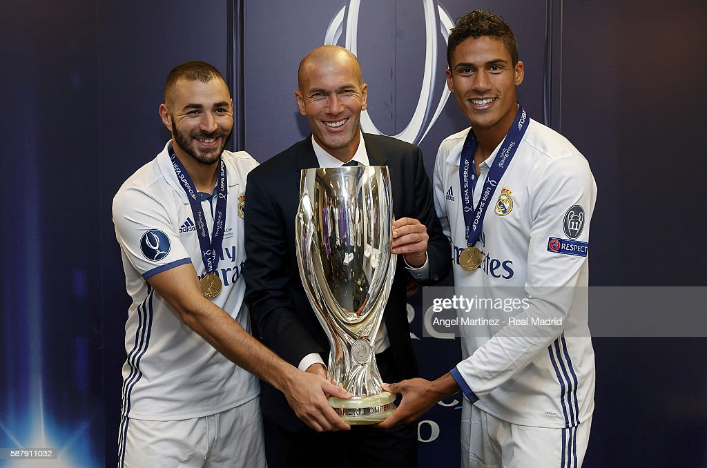 Head coach Zinedine Zidane (C) of Real Madrid poses with Karim Benzema (L) and Raphael Varane after the UEFA Super Cup match between Real Madrid and Sevilla at Lerkendal Stadion on August 9, 2016 in Trondheim, Norway.