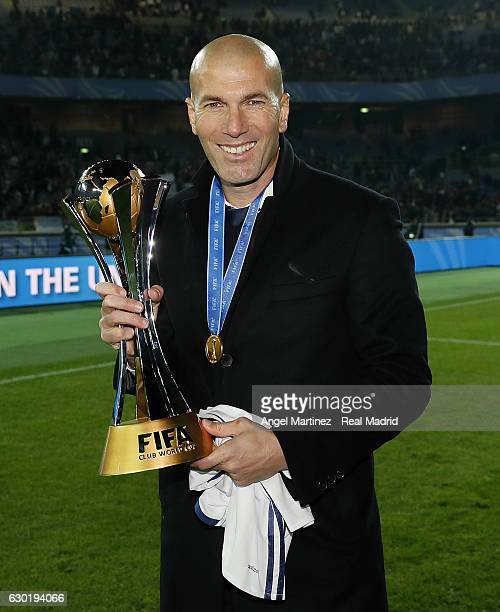Head coach Zinedine Zidane of Real Madrid poses with the trophy after the FIFA Club World Cup Final match between Real Madrid and Kashima Antlers at...