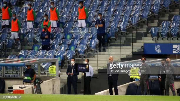 Head coach Zinedine Zidane of Real Madrid Sits on the bench prior to the La Liga Santader match between Real Sociedad and Real Madrid at Estadio...