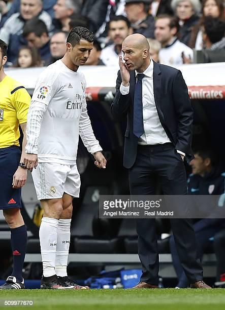 Head coach Zinedine Zidane of Real Madrid talks with Cristiano Ronaldo during the La Liga match between Real Madrid CF and Athletic Club at Estadio...