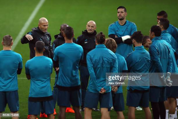 Head coach Zinedine Zidane talks to the players during a Real Madrid training session ahead of their UEFA Champions League Group H match against...