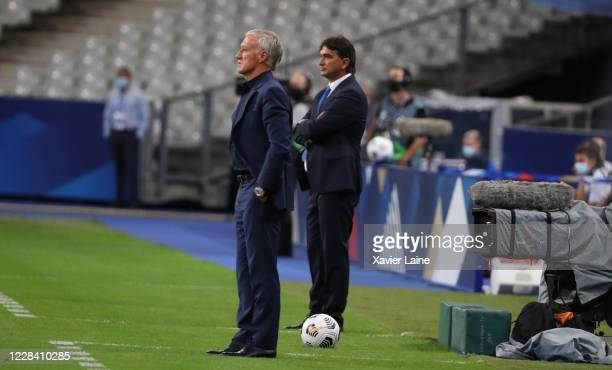Head coach Zlatko Dalic of Croatia and head coach Didier Deschamps of France look on from the sidelines during the UEFA Nations League group stage...