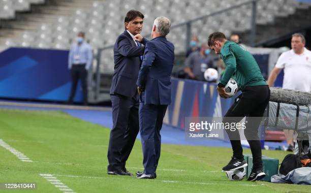 Head coach Zlatko Dalic of Croatia bumps fists with head coach Didier Deschamps of France during the UEFA Nations League group stage match between...
