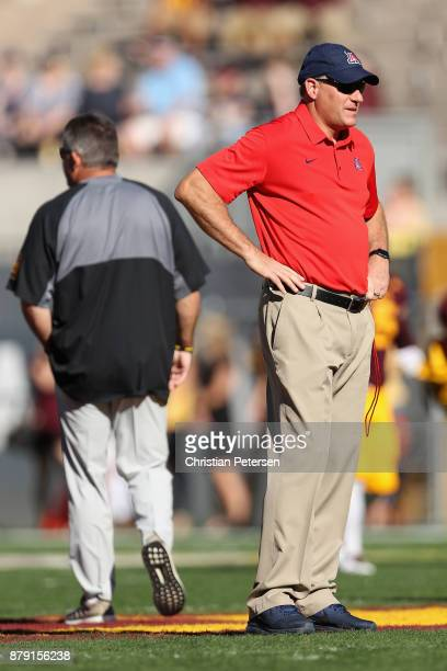 Head coache Rich Rodriguez of the Arizona Wildcats looks on as Todd Graham of the Arizona State Sun Devils walks away before the college football...