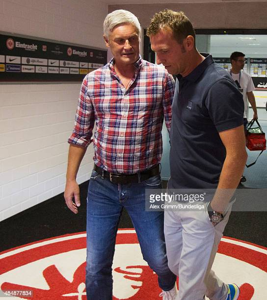 Head coaches Armin Veh of Frankfurt and Markus Weinzierl of Augsburg chat in the tunnel prior to the Bundesliga match between Eintracht Frankfurt and...