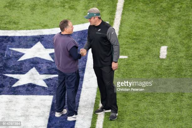 Head coaches Bill Belichick of the New England Patriots and Doug Pederson of the Philadelphia Eagles shake hands prior to Super Bowl LII at US Bank...