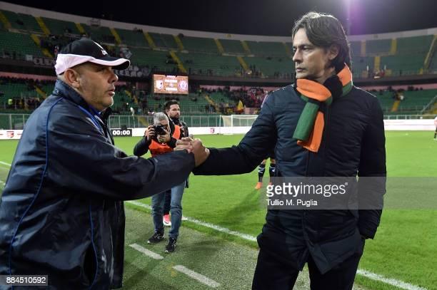 Head coaches Bruno Tedino of Palermo and Filippo Inzaghi of Venezia shake hands prior the Serie B match between US Citta di Palermo and FC Venezia at...