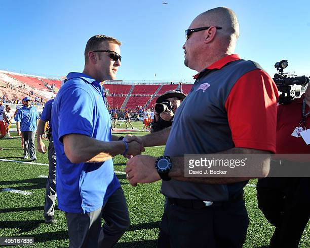 Head coaches Bryan Harsin of the Boise State Broncos and Tony Sanchez of the UNLV Rebels greet on the field after the Bronco defeated the Rebels 5527...
