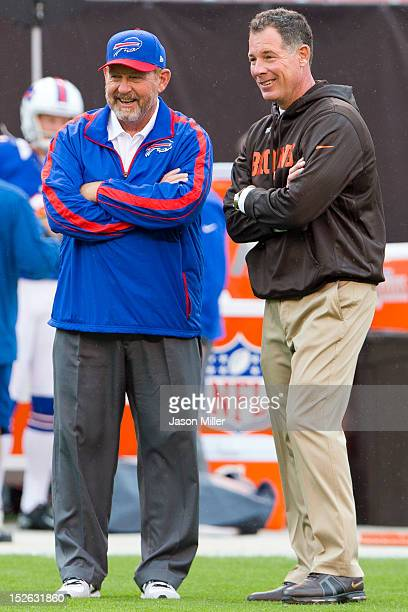 Head coaches Chan Gailey of the Buffalo Bills talks with Pat Shurmur of the Cleveland Browns prior to the start of the game at Cleveland Browns...