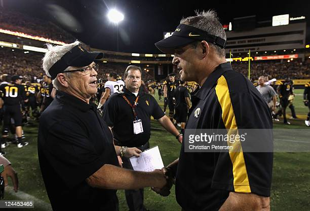 Head coaches Dennis Erickson of the Arizona State Sun Devils and Gary Pinkel of the Missouri Tigers shake hands following the college football game...