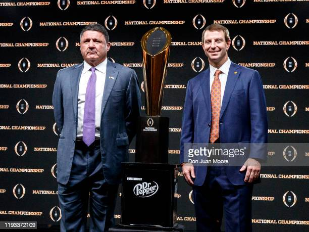 Head Coaches Ed Orgeron of the LSU Tigers and Dado Swinney of the Clemson Tigers pose with The College Football Playoff National Championship Trophy...