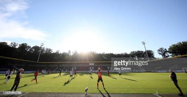 Head coaches Hans-Jurgen Boysen of Grossaspach and Michael Koellner of 1860 Muenchen during the 3. Liga match between SG Sonnenhof Grossaspach and...