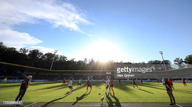 Head coaches Hans-Jurgen Boysen of Grossaspach and Michael Koellner of 1860 Muenchen watch the match from the sideline during the 3. Liga match...