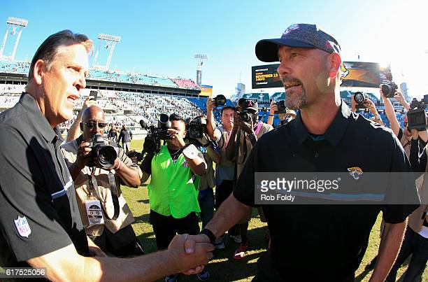 Head coaches Jack Del Rio of the Oakland Raiders and Gus Bradley of the Jacksonville Jaguars shake hands after the game at EverBank Field on October...