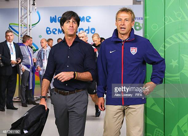 head coaches Joachim Loew of Germany and Jurgen Klinsmann of the United States speak in the tunnel prior to the 2014 FIFA World Cup Brazil Group G...