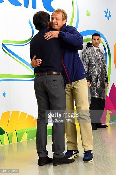 head coaches Joachim Loew of Germany and Jurgen Klinsmann of the United States hug in the tunnel prior to the 2014 FIFA World Cup Brazil Group G...