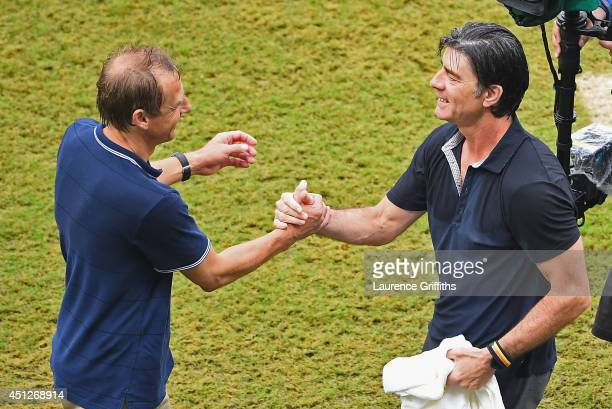 Head coaches Jurgen Klinsmann of the United States and Joachim Loew of Germany shake hands after Germany's 10 win during the 2014 FIFA World Cup...