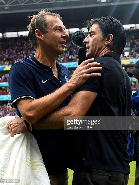 Head coaches Jurgen Klinsmann of the United States and Joachim Loew of Germany talk after the 2014 FIFA World Cup Brazil Group G match between USA...
