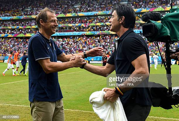 Head coaches Jurgen Klinsmann of the United States and Joachim Loew of Germany shake hands after the 2014 FIFA World Cup Brazil Group G match between...