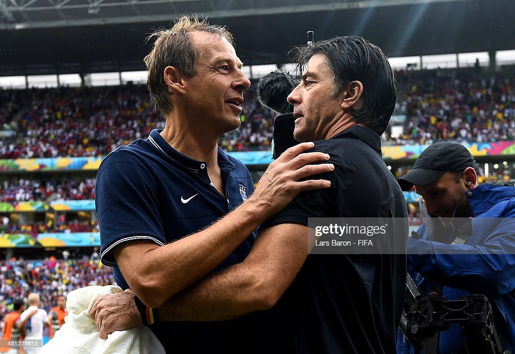 Head coaches Jurgen Klinsmann (L) of the United States and Joachim Loew of Germany talk after the 2014 FIFA World Cup Brazil Group G match between USA and Germany at Arena Pernambuco on June 26, 2014 in Recife, Brazil.