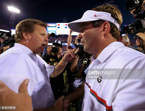 Head coaches Kirby Smart of the Georgia Bulldogs and Jim McElwain of the Florida Gators shake hands after the game at EverBank Field on October 29...