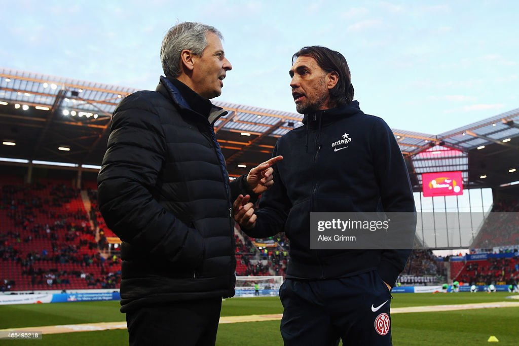Head coaches Martin Schmidt (R) of Mainz and Lucien Favre of Moenchengladbach chat prior to the Bundesliga match between 1. FSV Mainz 05 and Borussia Moenchengladbach at Coface Arena on March 7, 2015 in Mainz, Germany.