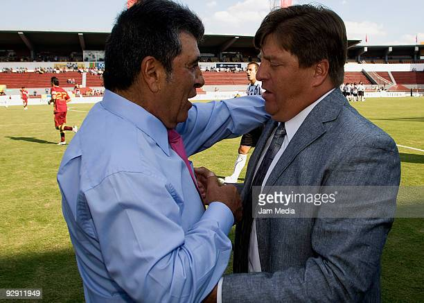 Head coaches Miguel Herrera of Estudiantes Tecos and Carlos Reinoso of Queretaro greet each other during a Mexican league Apertura 2009 soccer match...