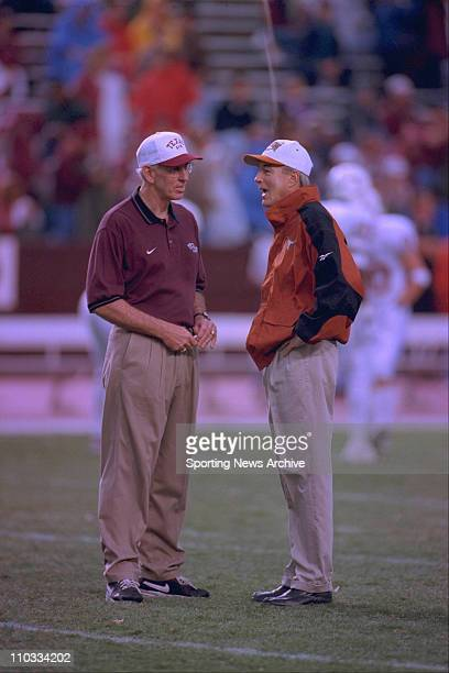 Head coaches RC Slocum of Texas AM and John Mackovic of Texas chat on Nov 28 1997 at Kyle Field in College Station Texas