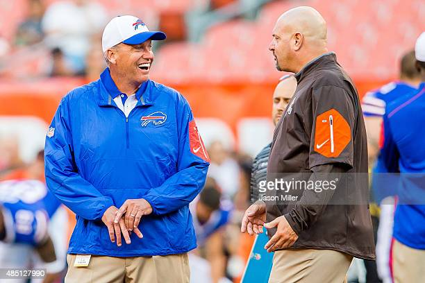 Head coaches Rex Ryan of the Buffalo Bills and Mike Pettine of the Cleveland Browns talk prior to a preseason game at FirstEnergy Stadium on August...